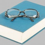 West Falmouth Library book with glasses